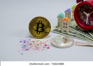 Golden Bitcoin on red clock,banknotes background.Photo of golden bitcoin (new virtual currency)