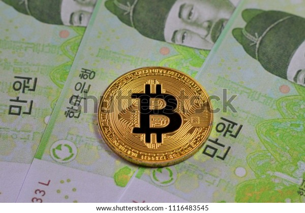 Golden Bitcoin on South Korea banknotes background , Cryptocurrency concept