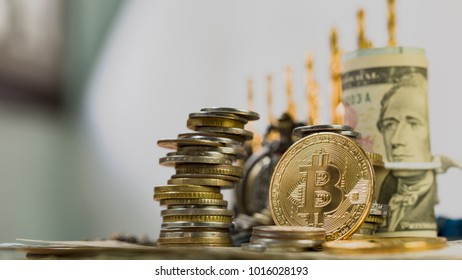 Golden Bitcoin On Top Of Pile Of US Dollar Banknote and Vintage Clock, Use As Business And Finance Concept.