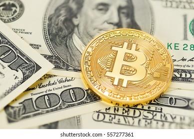Golden Bitcoin on US dollar bills. Electronic money exchange concept