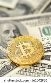 Golden Bitcoin on US dollar bills. Electronic money exchange concept