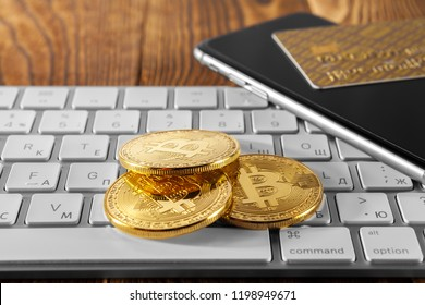 golden bitcoin on wood background