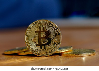 Golden Bitcoin on the wooden table, Cryptocurrency Digital Bit Coin on table, Virtual money concept