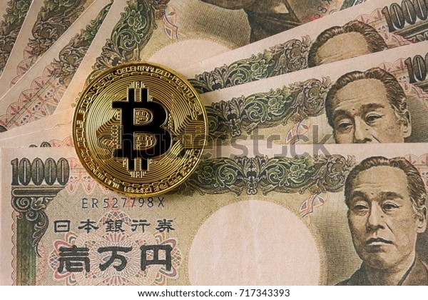 Golden Bitcoin on Yen Japan banknote background