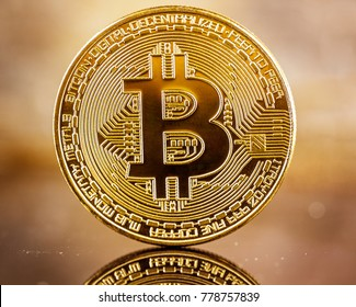 golden bitcoin over abstract background, close-up