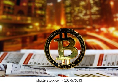 Golden  bitcoin over colorful background