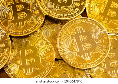 Golden Bitcoin pile background - Bitcoin mining business is the process of adding transaction records to Bitcoin public ledger of past transactions or blockchain. Cryptocurrency trading concept.