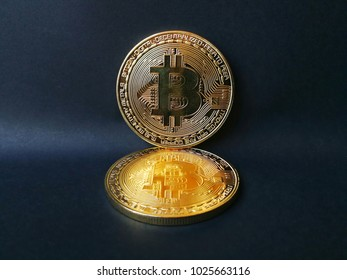 golden bitcoin placed on a black scene