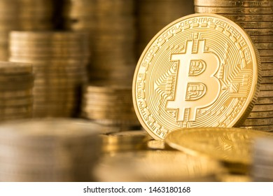 Golden bitcoin and stack of coins. Bitcoin BTC cryptocurrency, digital currency and wealth growth concept