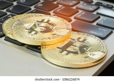The golden bitcoin is stacked on a black background, Conceptual image for worldwide crypto currency, huge stack physical version of golden Bitcoin.