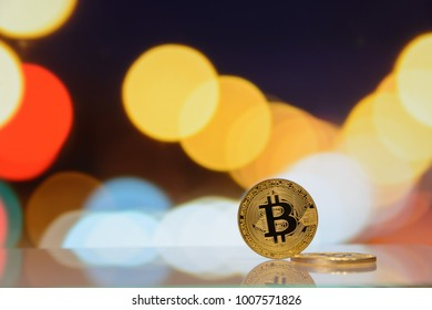 golden bitcoin stand on blurred lighting background