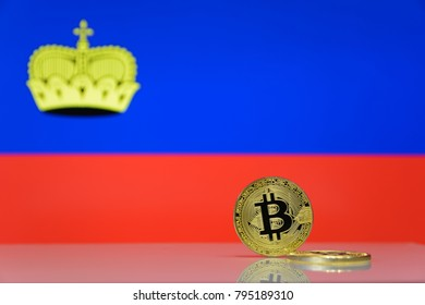 golden bitcoin stands on a blurred background of state flag of Liechtenstein