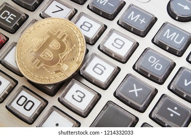 Golden bitcoin symbol on calculator background, count bitcon cost concept