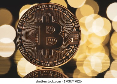 Golden bitcoin with yellow bokeh background. Cryptocurrency concept.