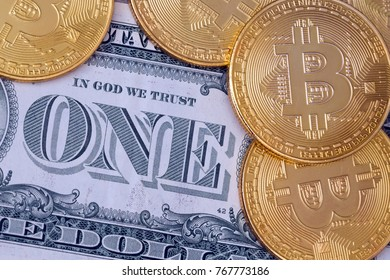 Golden  bitcoins and cash dollar bill in background