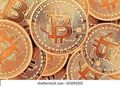 Golden Bitcoins close-up as a background.Photo (new virtual money ) .Conceptual photo.