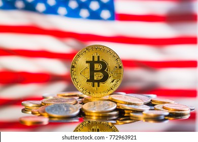 Golden bitcoins. Cryptocurrency in front of usa flag.