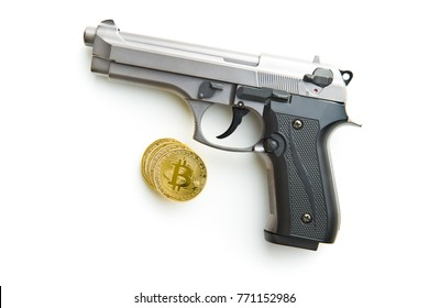 Golden bitcoins. Cryptocurrency and handgun isolated on white background.