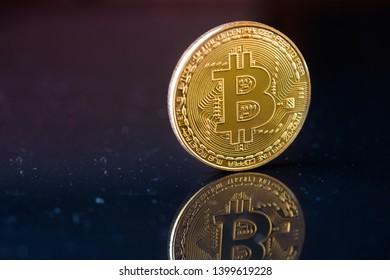 Golden Bitcoins with dark background. New virtual money on internet.