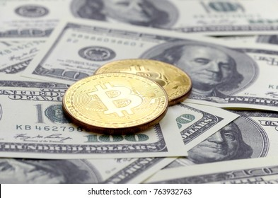 Golden bitcoins lie on a lot of dollar bills. The concept of raising the price of bitcoin relative to the US dollar