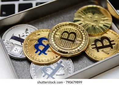 golden bitcoins in metal box on notebook keyboard
