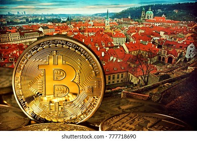 Golden Bitcoins on the background of Prague. Photo (new virtual money ) New crypto currency in the form of the coins.