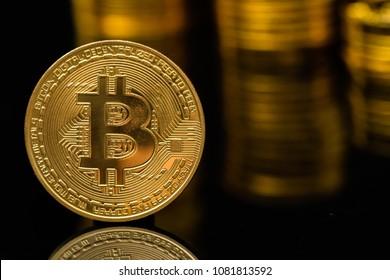 Golden bitcoins on black background.