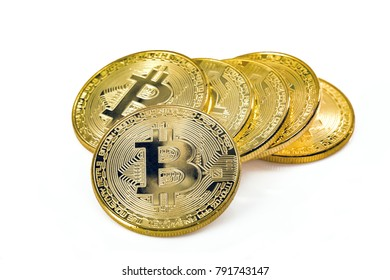 Golden Bitcoins on bright background