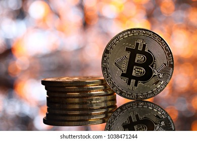 Golden bitcoins on the colorfull blur background, shallow focus