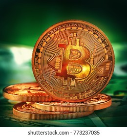 Golden Bitcoins on a green background .Photo (new virtual money ) New crypto currency in the form of the coins.