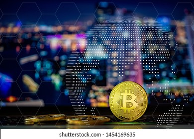 Golden Bitcoins on keyboard computer with stock graph background,Technologies connecting the world.