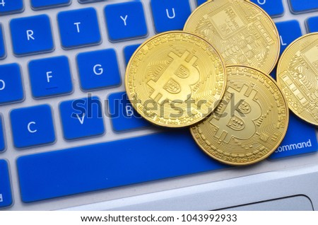 Golden Bitcoins on keyboard. Selective focus.