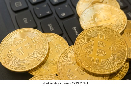 Golden Bitcoins on a laptop keyboard. Cryptocurrency