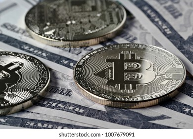 Golden bitcoins on the paper money, shallow focus