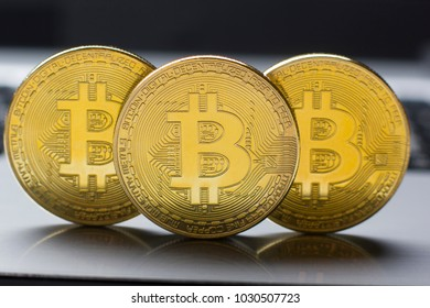 Golden Bitcoins on US dollars. Electronic money exchange concept