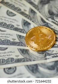 Golden Bitcoins on US dollars. Electronic money exchange concept
