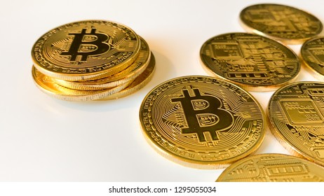 Golden bitcoins on the white background. Bitcoin is a convenient payment in a global economy market. Virtual digital currency and financial investment trade concept. Blockchain transfers concept.