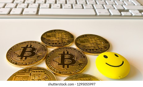Golden bitcoins on the white table. Bitcoin is a convenient payment in a global economy market. Virtual digital currency and financial investment trade concept. Blockchain transfers concept.