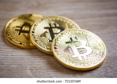 Golden bitcoins on wooden background