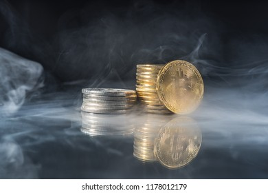 Golden bitcoins with smoke on black background. Business concept. Internet security and protection concept.