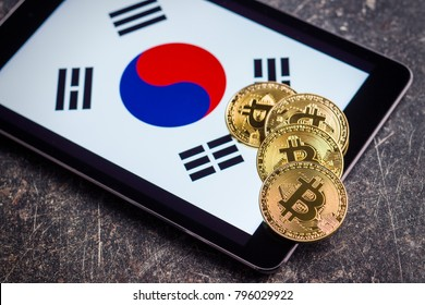Golden bitcoins and South Korea flag. Digital cryptocurrency.