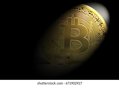 golden bitcoins with the spotlight