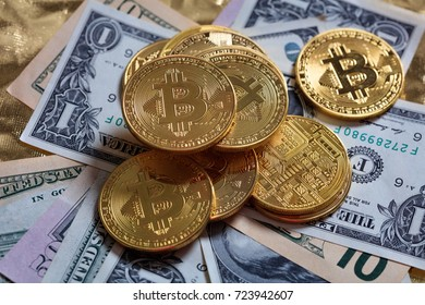 Golden bitcoins stacked on dollar banknotes background