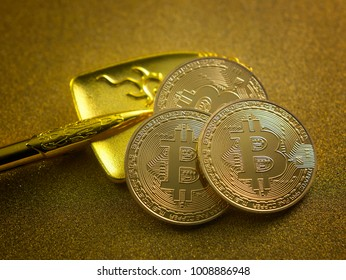 Golden Bitcoins,Bitcoin on Golden background - the new virtual money