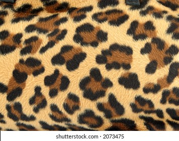 golden and black furry leopard print background