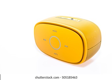 Golden bluetooth speaker .isolate on white background, mini bluetooth speaker