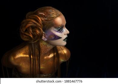 Golden body. Beautiful model in gold. Aries zodiac signs.Beautiful sexy girl