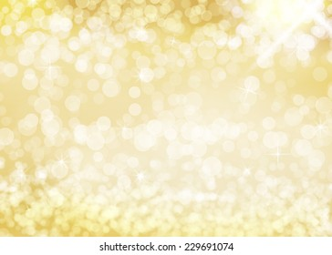 Golden bokeh background with glittering stars. With lots of copy space.