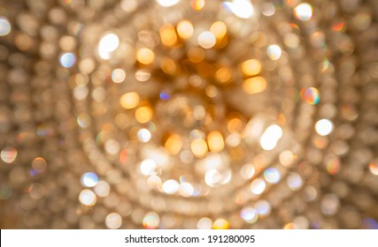 Golden bokeh from crystal chandelier