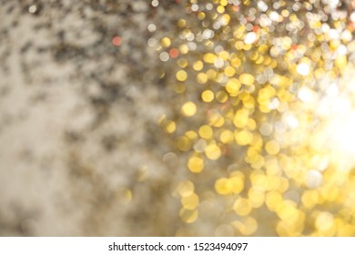 Golden bokeh or glister for abstract or festival background.